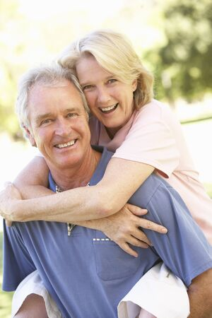 countryside loving: Portrait Of Romantic Senior Couple In Park