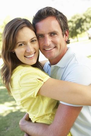 Portrait Of Romantic Couple In Park photo