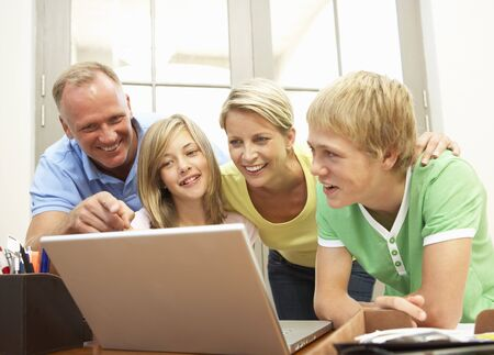 Family Using Laptop At Home photo