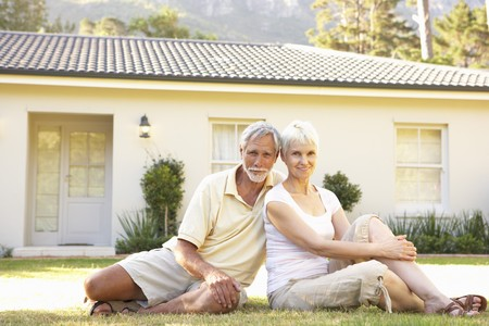 Senior Couple sitting Outside Dream Home photo