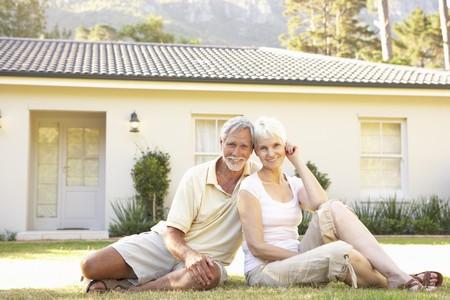 Senior Couple sitting Outside Dream Home Stock Photo - 8108813