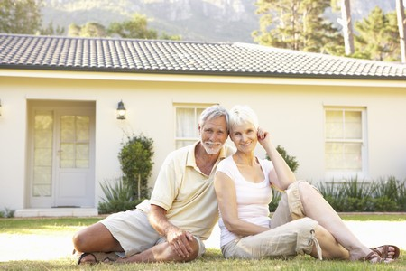 Senior Couple sitting Outside Dream Home Stock Photo - 8108813