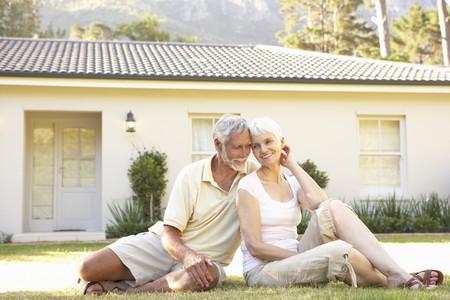 Senior Couple sitting Outside Dream Home photo