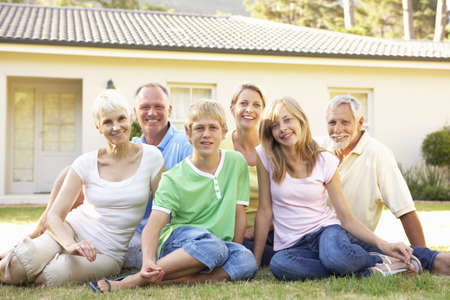 Extended Family Sitting Outside Dream Home Stock Photo - 8108857
