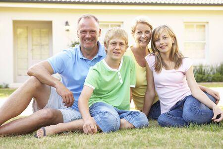 Dream Home: Family Sitting Outside Dream Home
