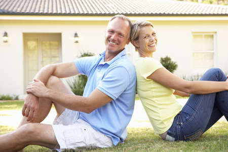 Couple Sitting Outside Dream Home Stock Photo - 8108841