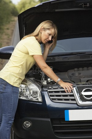 bonnet up: Female Driver Broken Down On Country Road