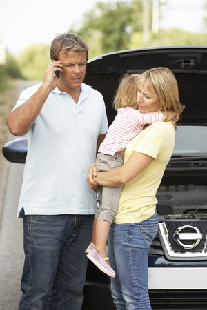 emergency call: Family Broken Down On Country Road Stock Photo