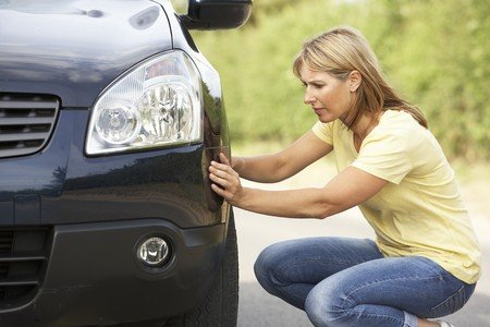flat tyre: Female Driver Broken Down On Country Road