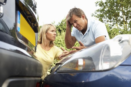 Man And Woman Having Argument After Traffic Accident Stock Photo - 8108809
