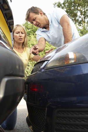 Man And Woman Having Argument After Traffic Accident Stock Photo - 8108790