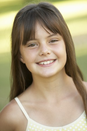 9 year old girl: Portrait Of Young Girl In Park