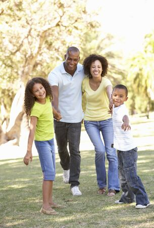 Portrait of Happy Family Walking In Park Stock Photo - 8108898