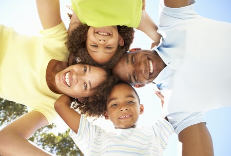 brazilian: Portrait of Happy Family Looking Down Into Camera In Park Stock Photo