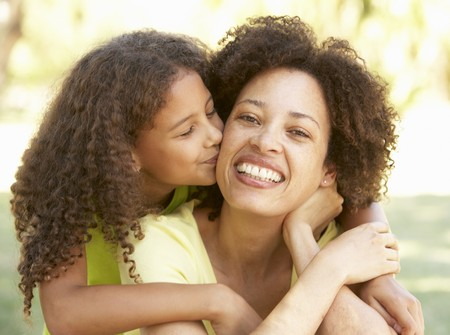 women hugging: Portrait Of Mother And Daughter In Park