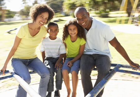 Family In Park Riding On Roundabout Stock Photo - 8108884