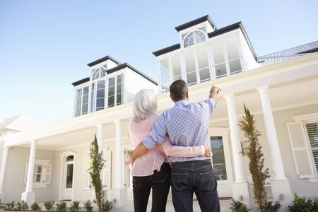 Senior Couple Standing Outside Dream Home photo