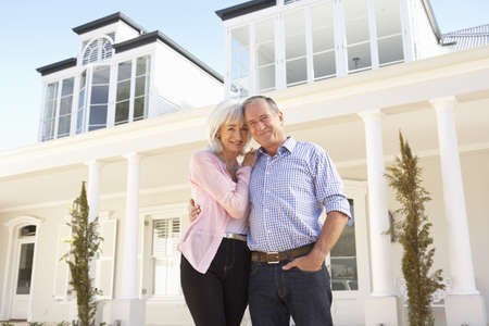 Senior Couple Standing Outside Dream Home Stock Photo - 8198723
