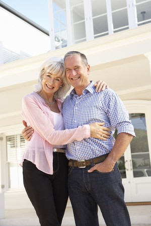 Dream Home: Senior Couple Standing Outside Dream Home