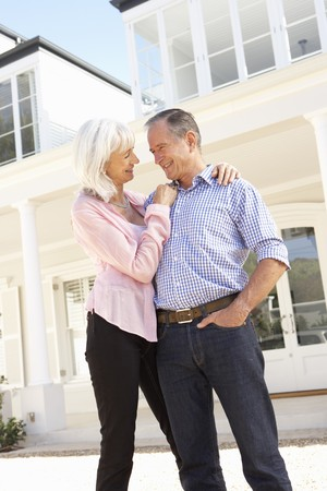 Senior Couple Standing Outside Dream Home Stock Photo - 8198776