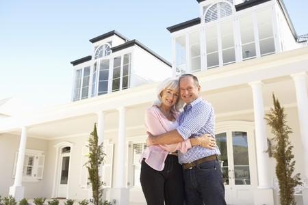 Senior Couple Standing Outside Dream Home Stock Photo - 8198683