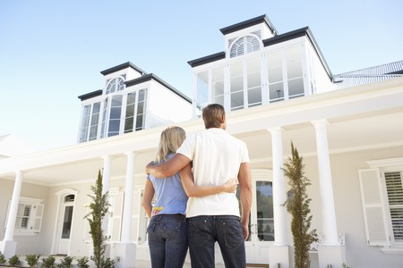 Young Couple Standing Outside Dream Home Stock Photo - 8198675
