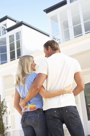 Young Couple Standing Outside Dream Home Stock Photo - 8198770