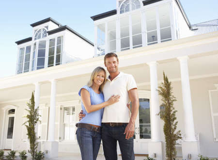 Young Couple Standing Outside Dream Home Stock Photo - 8198680