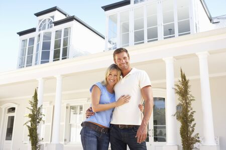 Young Couple Standing Outside Dream Home Stock Photo - 8198641