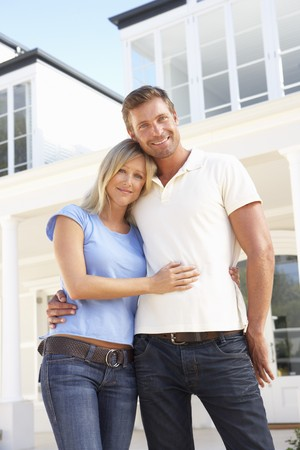 Young Couple Standing Outside Dream Home photo