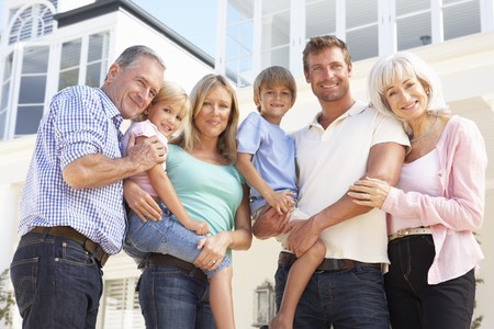 extended family: Extended Family Outside Modern House Stock Photo