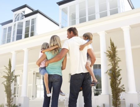 Young Family Standing Outside Dream Home Stock Photo - 8198764