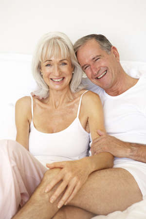 sexy bedroom: Senior Couple Relaxing On Bed Stock Photo