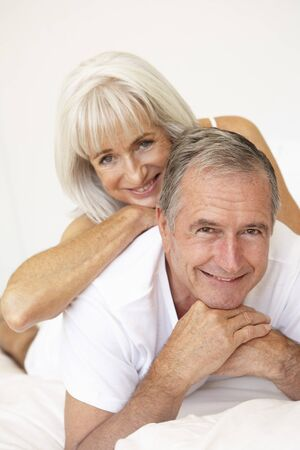sexy mature women: Senior Couple Relaxing On Bed Stock Photo