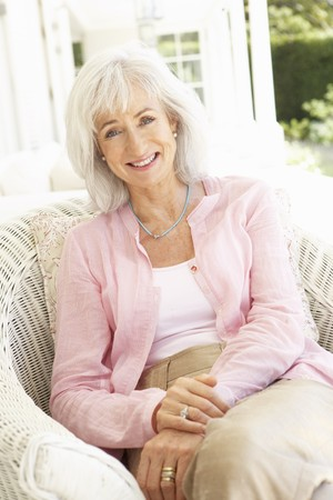 Portrait Of Senior Woman Relaxing In Chair Stock Photo - 8198846