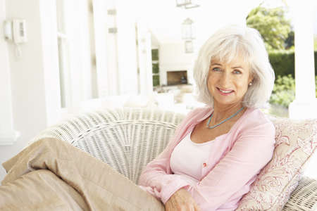 Portrait Of Senior Woman Relaxing In Chair Stock Photo - 8198750
