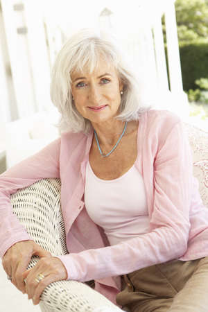 Portrait Of Senior Woman Relaxing In Chair Stock Photo - 8198842