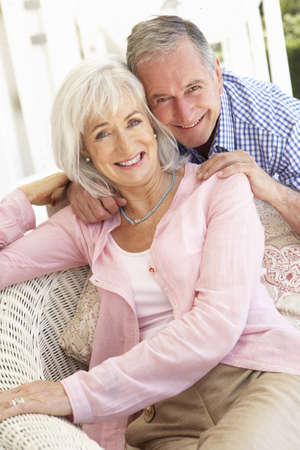 Portrait Of Senior Couple Relaxing Together On Sofa photo