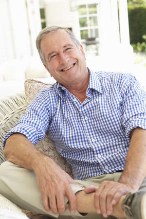 Portrait Of Senior Man Relaxing In Chair Stock Photo - 8198839