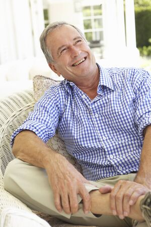 Portrait Of Senior Man Relaxing In Chair Stock Photo - 8198867