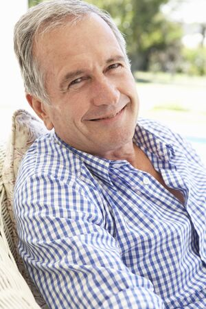 Portrait Of Senior Man Relaxing In Chair Stock Photo - 8198887