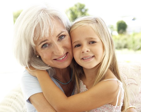 Portrait Of Grandmother With Granddaughter Relaxing Together On Sofa Stock Photo - 8198760