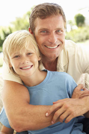 Portrait Of Father And Son Relaxing On Sofa Stock Photo - 8198799