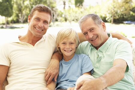 three generation: Portrait Of Grandfather, Son And Grandson Relaxing On Sofa