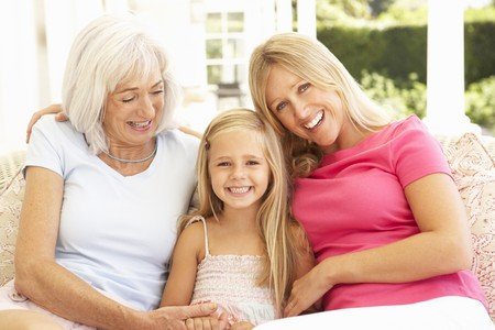 mature old generation: Portrait Of Grandmother, Daughter And Granddaughter Relaxing On Sofa