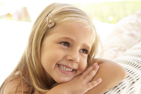 5 year old: Portrait Of Young Girl Relaxing On Sofa Stock Photo
