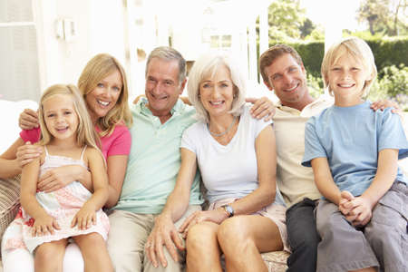 mature old generation: Extended Family Relaxing Together On Sofa