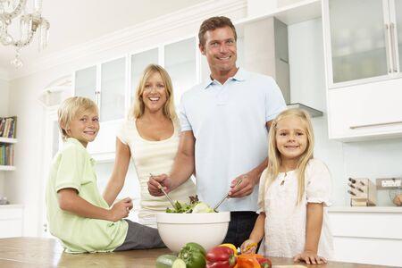 modern kitchen: Family Preparing Salad In Modern Kitchen