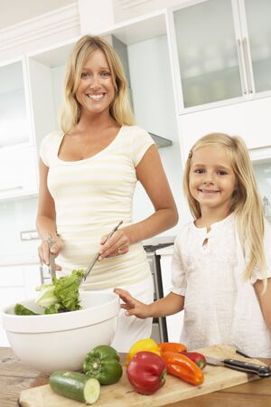 Mother & Daughter Preparing Salad In Modern Kitchen Stock Photo - 8198687