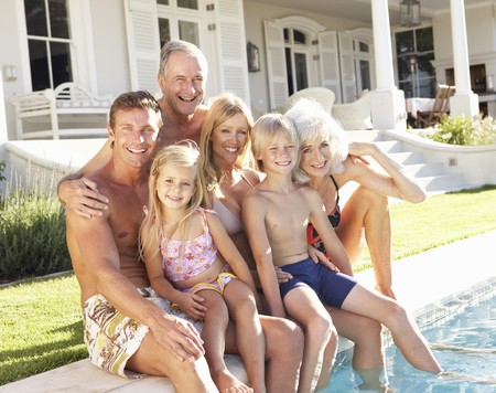 Extended Family Outside Relaxing By Swimming Pool Stock Photo - 8198880